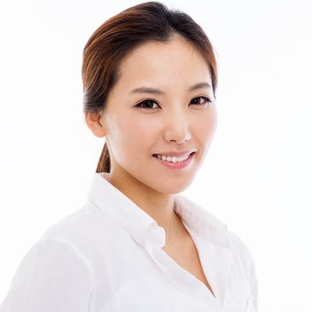 행복 한 젊은 아시아 여자 총 흰색 배경에 고립 된 닫습니다. 스톡 콘텐츠