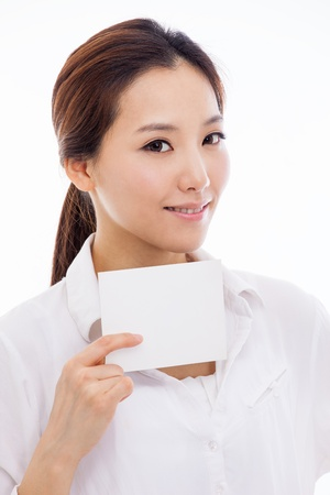 Asian woman showing empty card isolated on white background. photo