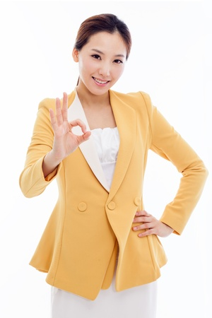 Young Asian business woman showing okay sign isolated on white background.  photo