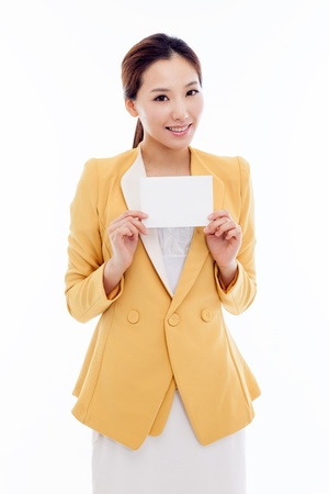 Business woman showing blank card. isolated over white photo