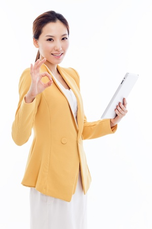 Asian Business woman using pad PC isolated on white background.  photo