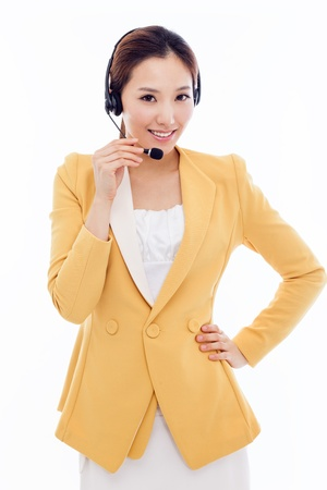 helpline: Smiling call center operator business woman isolated on white background.