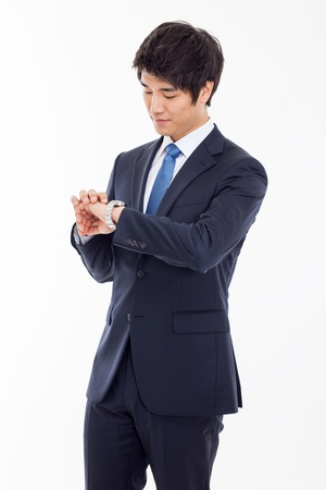 watch over: Young business man consulting his watch, isolated over white Stock Photo
