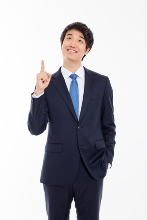 indicating: Young asian man indicated up side isolated on white background.