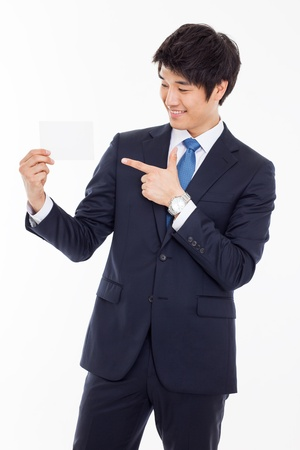 Asian young business man with blank card isolated on white background  Stockfoto