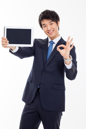 Young Asian business man showing a pad PC  isolated on white background.
