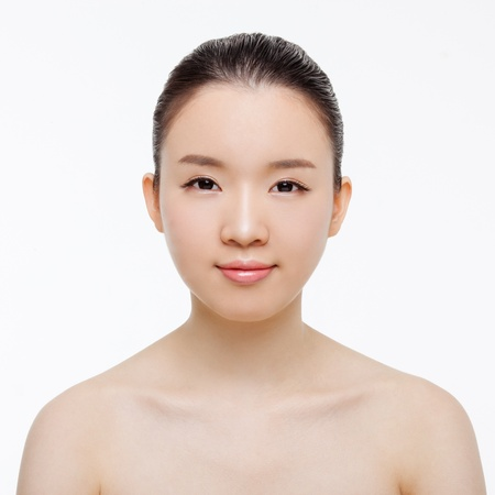 Asian woman beauty shot isolated on white background.