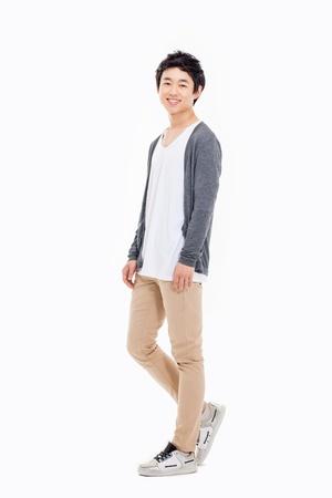 Jonge Aziatische man geà ¯ soleerd op witte achtergrond. Stockfoto - 20019781