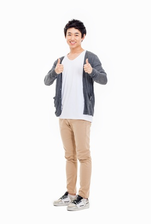 Showing thumb Asian young  man  isolated on white background. Stockfoto
