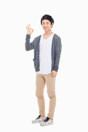one young man: Young asian man showing okay sign isolated on white background.