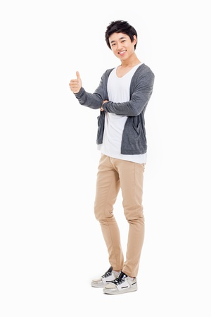 Showing thumb Asian young  man  isolated on white background. photo