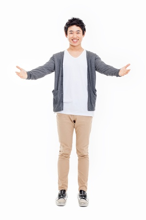 welcome smile: Young Asian man showing welcome sign isolated on white background.  Stock Photo