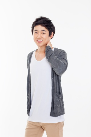 male teenager: Young Asian man with smiling isolated on white background. Stock Photo