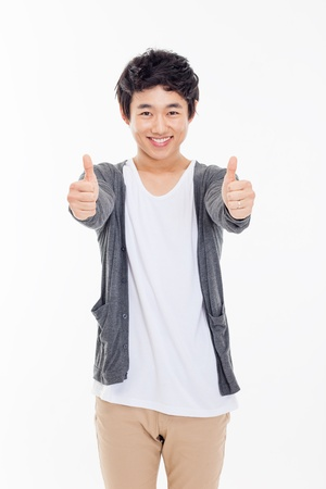 thumbs up sign: Young Asian man showing thumb isolated on white background.
