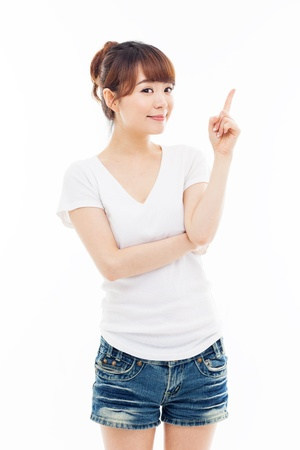 Young Asian woman showing something isolated on white background