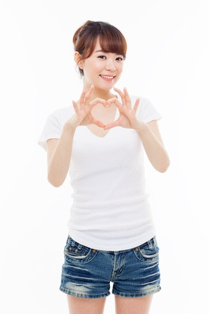 Beautiful Asian casual woman show heart shape isolated on white background Фото со стока - 20239015