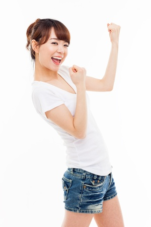 Young Asian woman showing fist isolated on white background