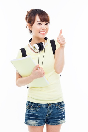 Young happy Asian student show thumb isolated on white. Stok Fotoğraf