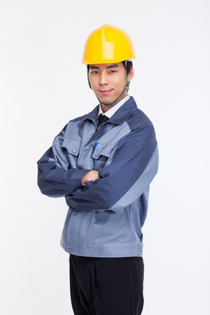 Young Asian engineer isolated on white.