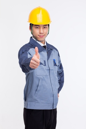 asian architect: Young Asian engineer isolated on white.