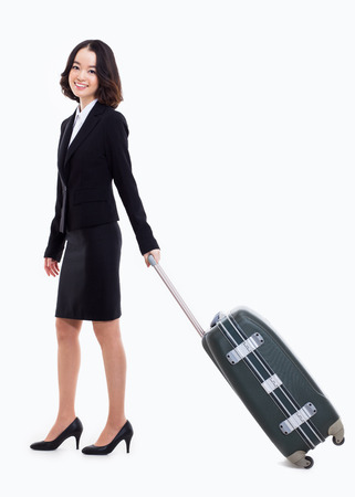Cheerful businesswomen with travel bag isolated on white photo