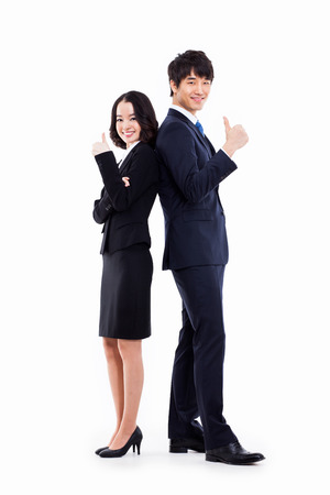 Business couple showing thumb isolated on white . photo