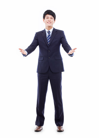 welcom: Young Asian business man showing welcom sign  Stock Photo