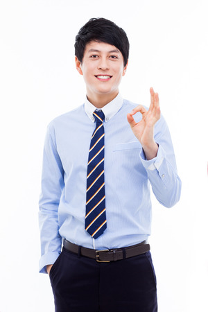 okay sign: Young Asian business man showing okay sign