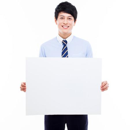 白紙の横断幕を抱きかかえた若いアジア ビジネス