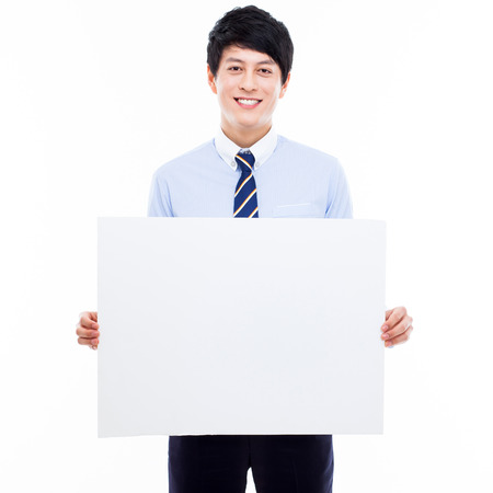 holding business card: Young Asian business man holding a blank banner
