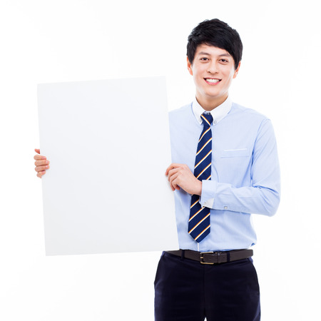 Young Asian business man holding a blank banner  photo