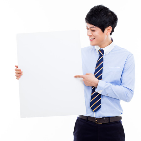 pannel: Young Asian business man holding a blank banner