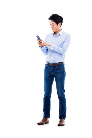 Young Asian man using phone isolated on white bakcground.
