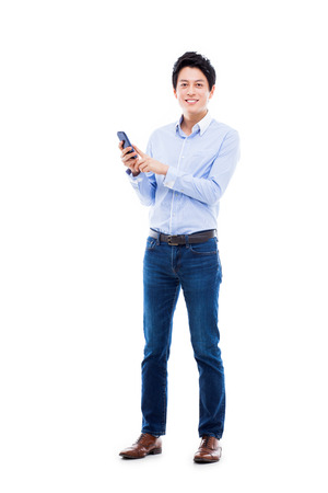 one young man: Young Asian man using phone isolated on white bakcground.