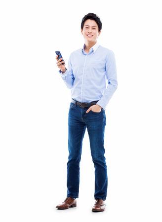Young Asian man using phone isolated on white bakcground.