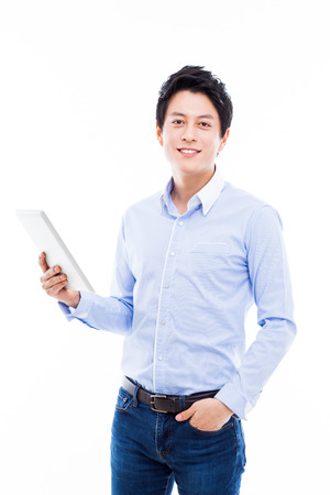 young Asian man having a smard pad PC isolated on white background.