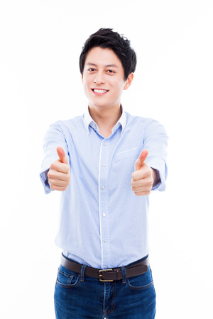 Young Asian man showing thumb isolated on white background.  photo