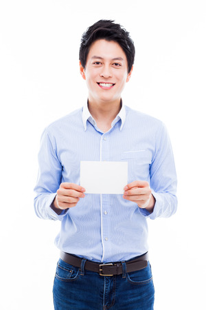 Young asian man showing empty card isolated on white background.  photo