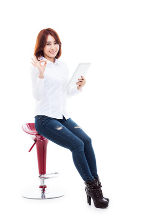 computer isolated: Woman holding tablet computer isolated on white background.