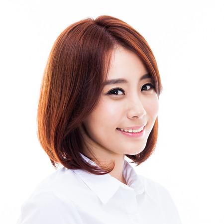 幸せな若いアジアの女性をクローズ アップ ショットで孤立した白い背景。 写真素材