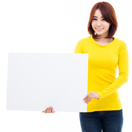 Young Asian woman holding a white board isolated on white background. photo