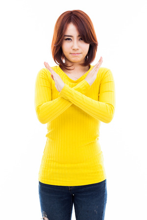 Young Asian woman show prohibit sign isolated on white background.