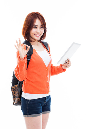 Young Asian student woman using a pad PC isolated on white background.  Stock Photo - 25024571