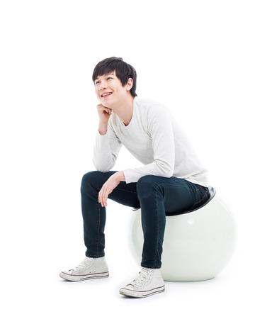 Young Asian man thinking on the chair isolated on white backgroung. Фото со стока - 25161461