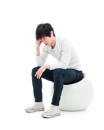 Young Asian man having a stress isolated on white background.