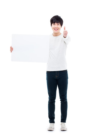 Asian young man showing pannel isolated on white background.  photo