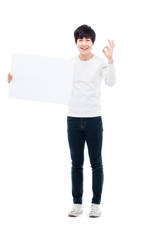 pannel: Asian young man showing pannel isolated on white background.