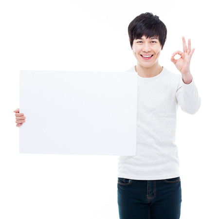 Young Asian man showing a pannel card isolated on white background.  photo
