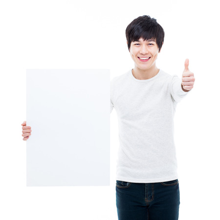 pannel: Young Asian man showing a pannel card isolated on white background.