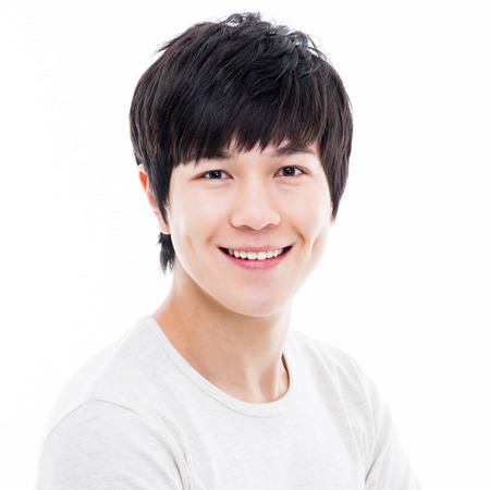 Young Asian man close up shot isolated on white  Фото со стока